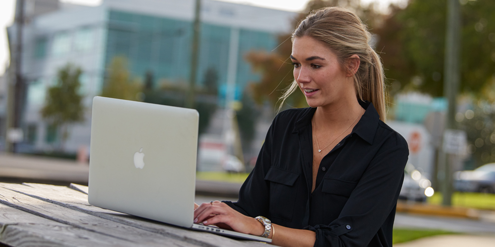 individual reading on a laptop