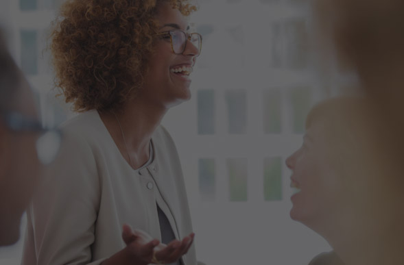 Woman laughing in meeting.