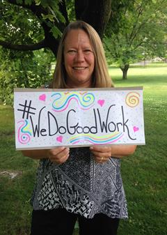 An emplyoee, Jane, holding a sign that says We Do Good Work