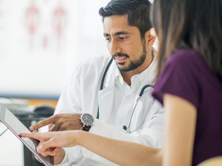 A doctor examining something