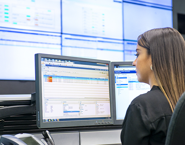 Data analyst at desk looking at dashboard analytics