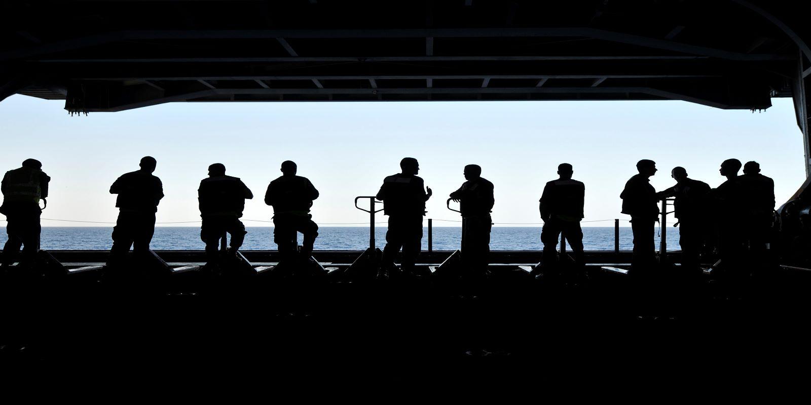 sailors aboard the aircraft carrier USS Carl Vinson