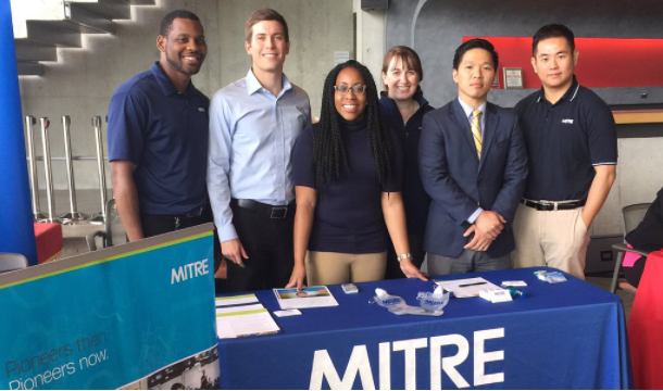 MITRE employees at a hiring event