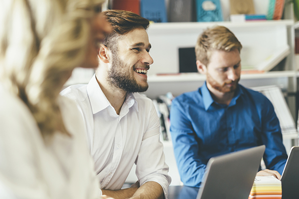 Man smiling in conference meeting room