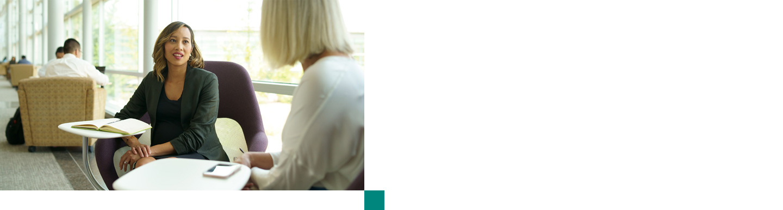 Diverse women talking professionally in an office