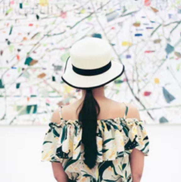 A girl standing facing backwards