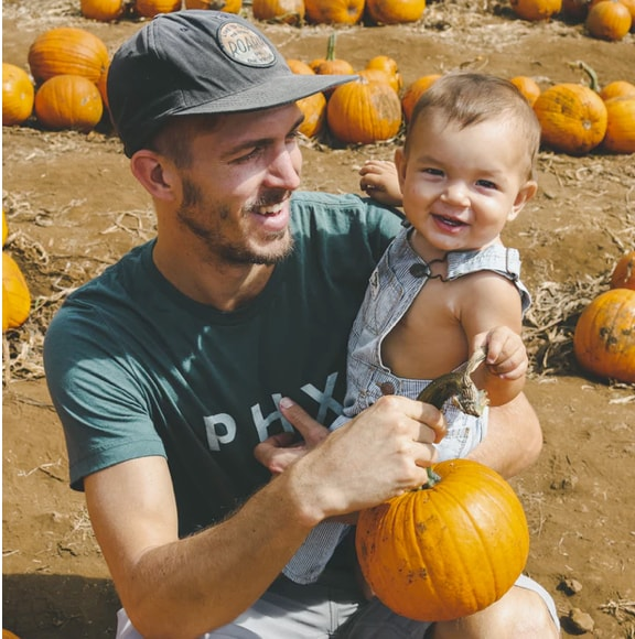 A fater and son plucking pumkins
