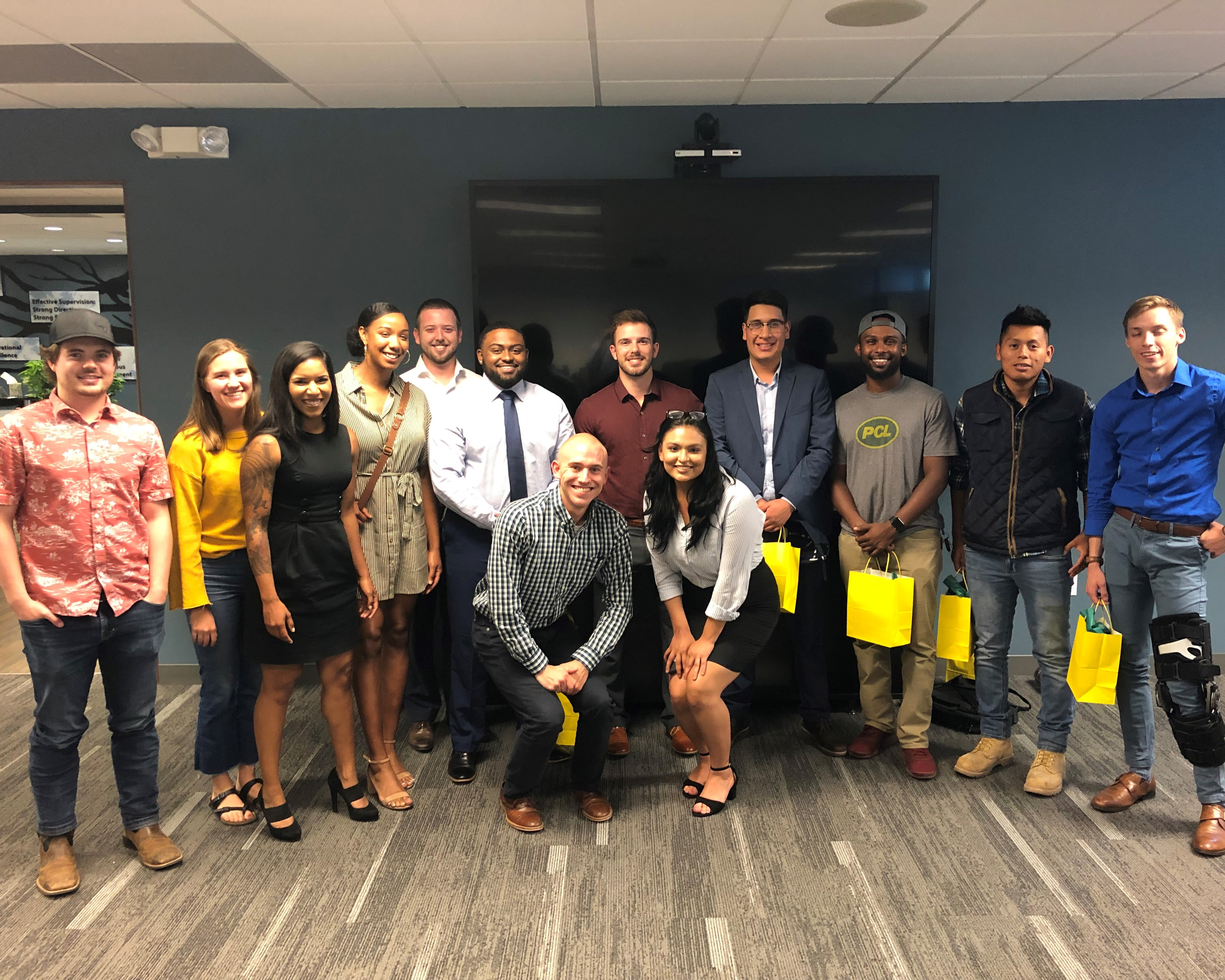 Blog writer, Vanna, stands with a group of 12 other PCL interns