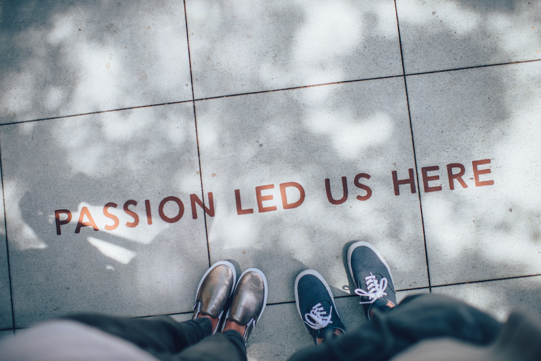 """""""Passion led us here"""" printed on ground"""