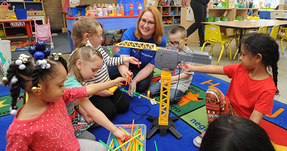 PNC employee volunteers in classroom with young children