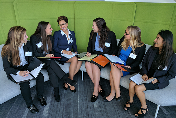 Collegiate women work together on an assignment