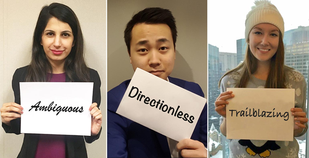 Collage of three Career launch associates, each holding a sheet of paper with a word written on it. From left to right the words are: ambiguous, directionless, and trailblazing.