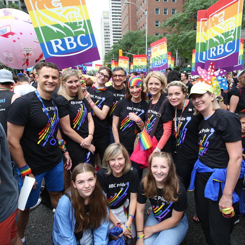 Groups of RBC employees wearing RBC Pride t-shirts during the RBC Pride parade.