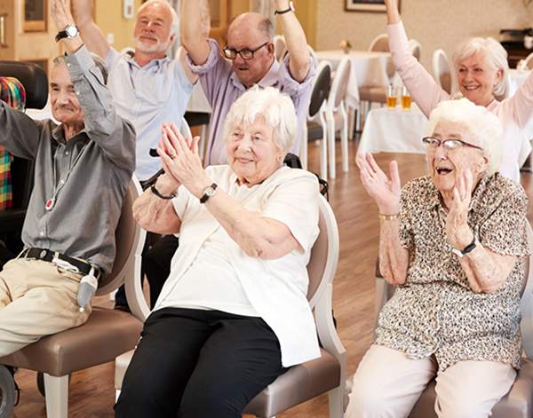 image of a group of seniors clapping their hands