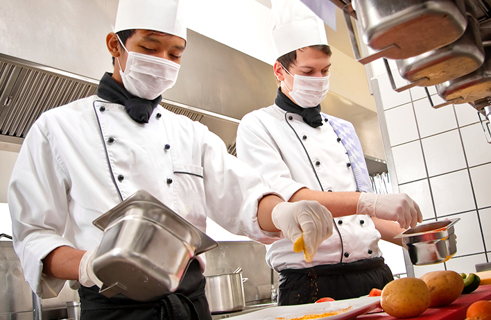 image of two male chefs preparing meals