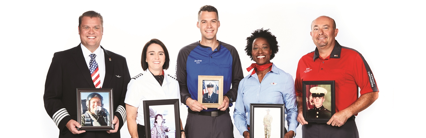 Five Southwest Employees stand together holding images of themselves in the military