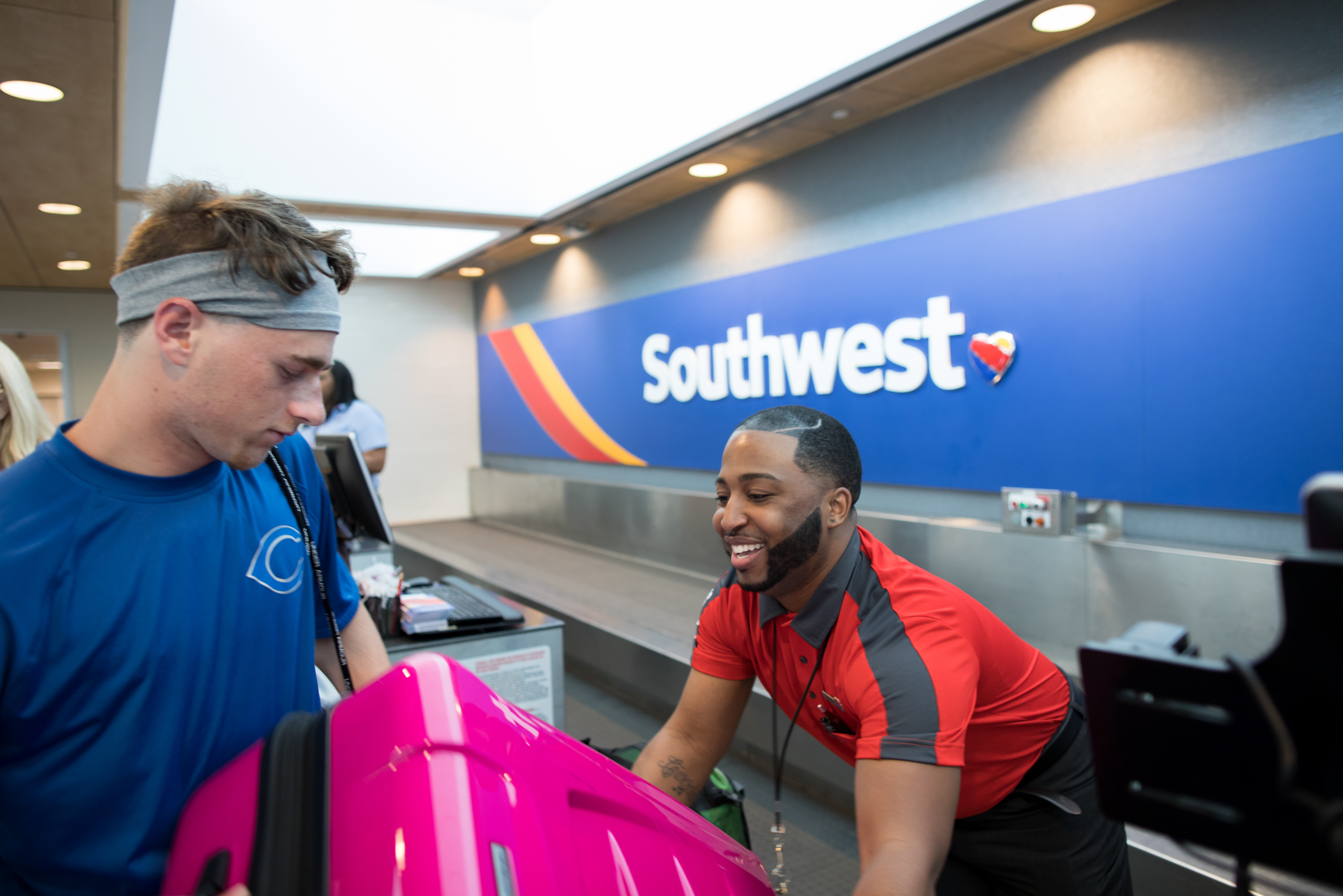 A Southwest Employee helps a Customer with his luggage