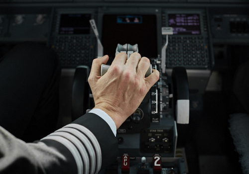 A Pilot's hand in the cockpit