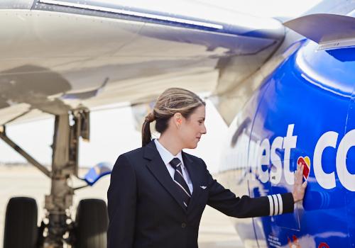 A Southwest Pilot touches the heart on a Southwest plane