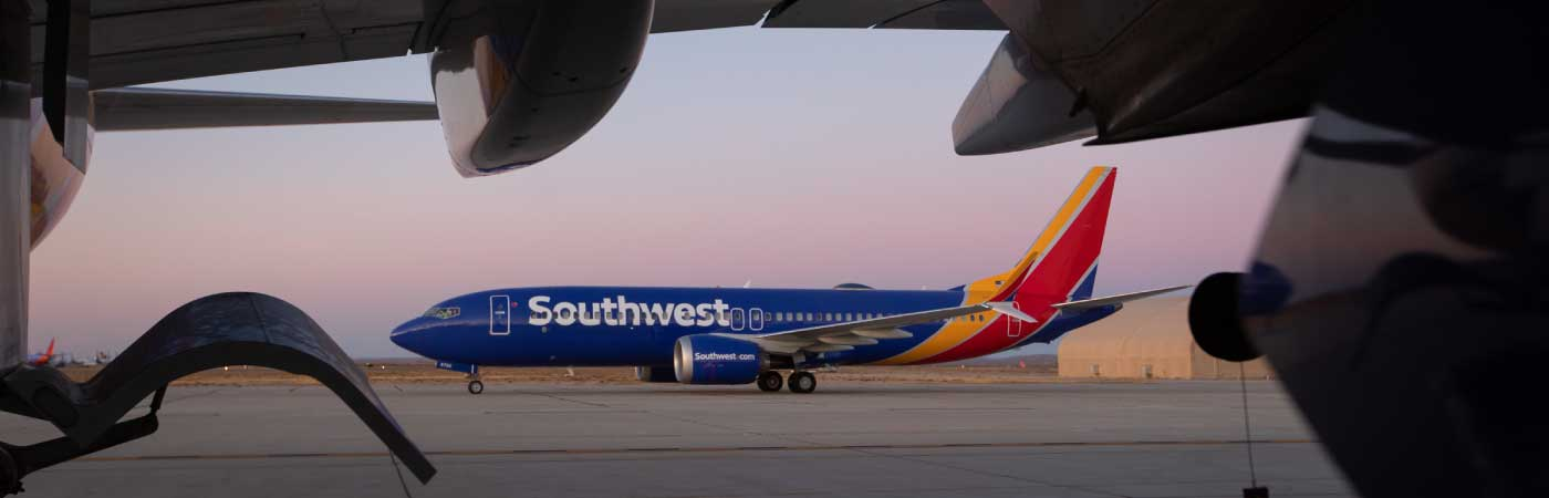 Southwest Airplane on a tarmac at sunrise.