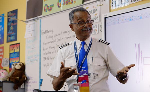 Adopt-A-Pilot Captain Atif Fareed teaches a class