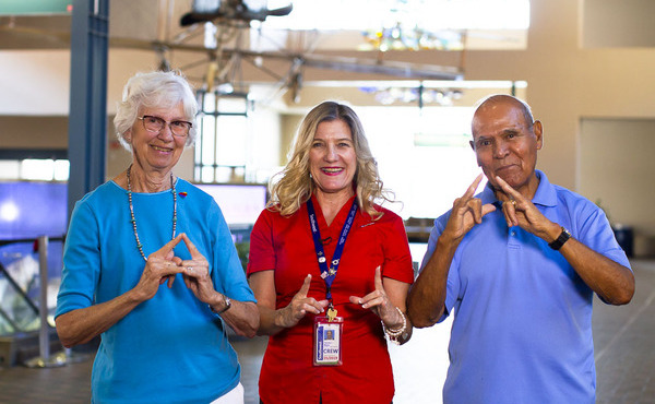A Southwest Employee and two Customers sign together