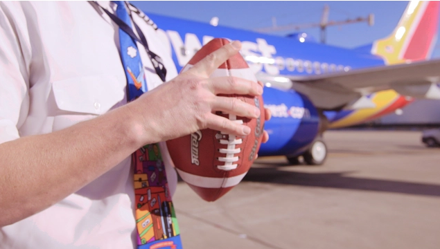 A Southwest Airlines Employees holds a football