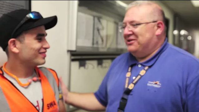 A former Southwest Airlines Summer Camper stands with another Employee