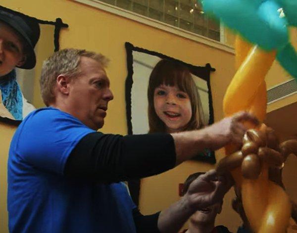 Southwest Mechanic Randy Ward creates a balloon animal