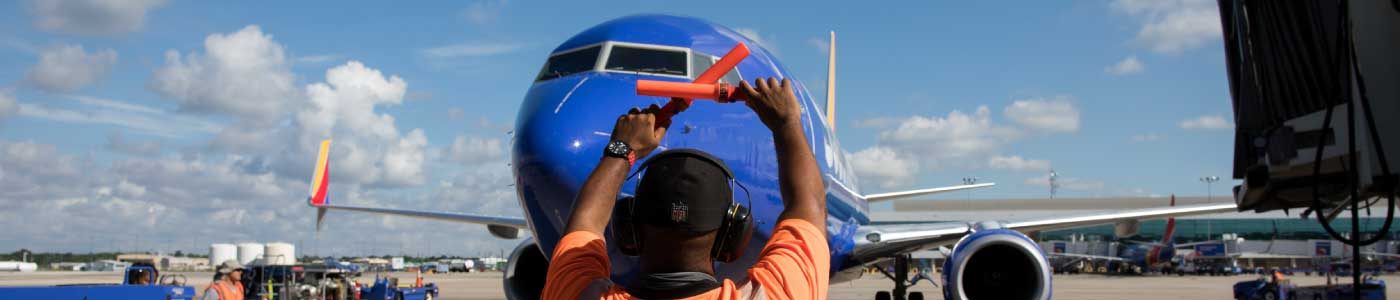 Ramp Agent marshals in a Southwest p