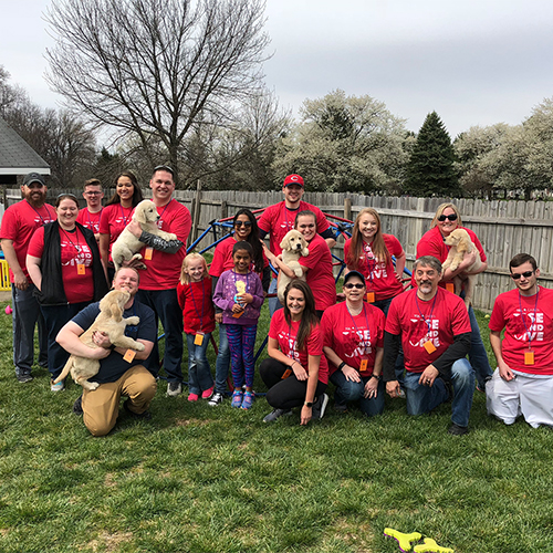 TQL Employees Volunteering with 4PawsForAbility