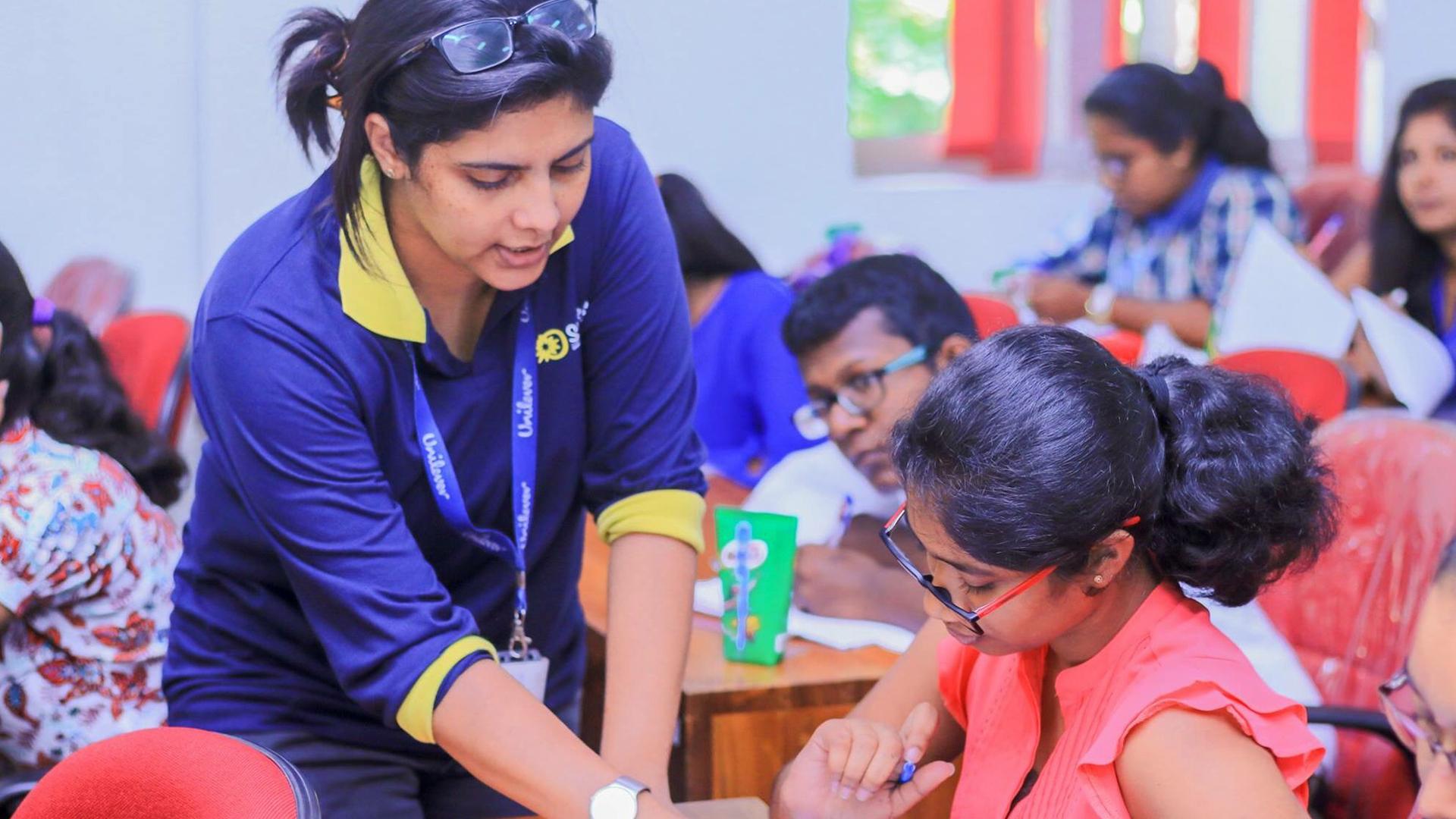 Unilever employee teaching at a school