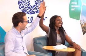 Marketing employees high five
